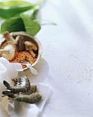 Shrimps; red lentils & mushrooms in wooden bowl; ramsons