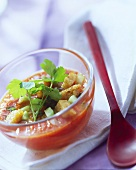 Gazpacho with croutons in a glass bowl