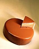 Chocolate cake with piece raised up