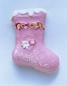 Pink boot biscuits, decorated with icing