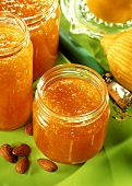 Carrot jam with almonds and ginger in jars