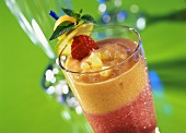 Fruity summer cocktail with pineapple & raspberries
