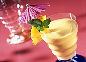 Smoothie with exotic fruits, coconut milk and rum
