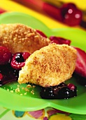 Semolina dumplings with compote on green plate