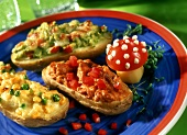 Baked potatoes with various toppings, with tomato fly agarics