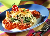 Pasta bake with tomato sauce and tomato head decoration