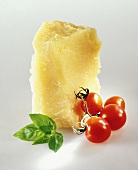 Piece of parmesan, vine tomatoes and basil