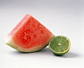 Slice of water melon and half a lime
