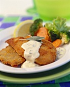 Chicken cutlet with tartar sauce and vegetables