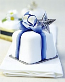 Christmas cake with blue bow and silver star