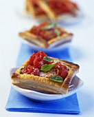 Puff pastry squares with tomatoes and fresh basil