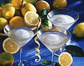 Lemon sorbet in champagne, surrounded by fresh lemons