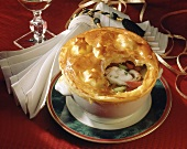 Fish stew under puff pastry topping for Christmas