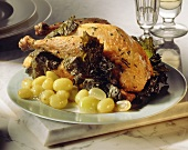 Roast chicken with green grapes and vine leaves