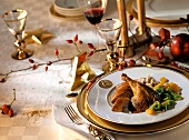 Duck with savoy and nut balls on Christmas table