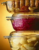 Potatoes, red cabbage & meat in glass pots