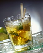 Caipirinha cocktail with limes and ice cubes