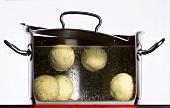 Dumplings boiling in a pan of water
