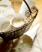 Several packets of rice in a wire basket