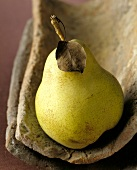 Yellow pear with stalk and leaf