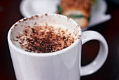Frothy milk with cocoa powder