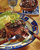 Tequila steaks with bean salsa on plate