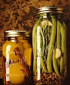 Bottled peaches and spicy green beans in jars