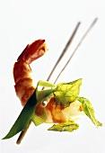 Shrimp between chopsticks