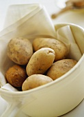 Potatoes with cloth in white dish