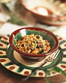Rice salad with vegetables in ceramic dish