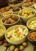 Various dried fruits and nuts in bowls