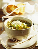 Courgette soup with courgette flowers and mozzarella