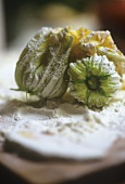 Courgette flowers, tossed in flour