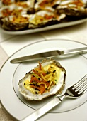 Oysters with julienne vegetables and champagne sauce