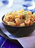 Pasta salad with yellow peppers, capers and dill