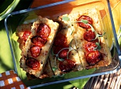 Rice cheese tart with cherry tomatoes in glass bowl for picnic
