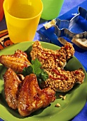 Two kinds of nibbles: chicken wings and peanut crostini