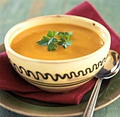 Carrot soup with coriander in a bowl