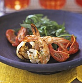 Grilled jumbo prawns with fried tomatoes on a plate