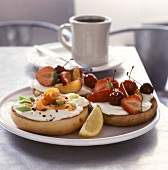 Bagels with salmon and fruit for breakfast