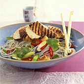 Grilled chicken breast on Asian noodle salad
