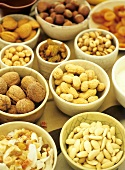 Various nuts and dried fruits in bowls