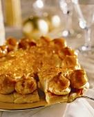 Profiterole tart with caramel glaze