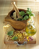 Ingredients for pesto: parmesan, basil, olive oil, pine nuts
