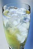 Drink with ice cubes against a pale blue backdrop