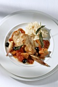 Rabbit with tomatoes, olives and mashed potato