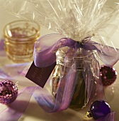 Preserving jar in Christmas wrapping as a gift