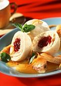 Cranberry dumplings with bananas in orange sauce