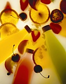 Yoghurt fruit drinks in bottles surrounded by fruit