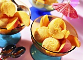 Mango and peach ice cream with peach slices and parasol